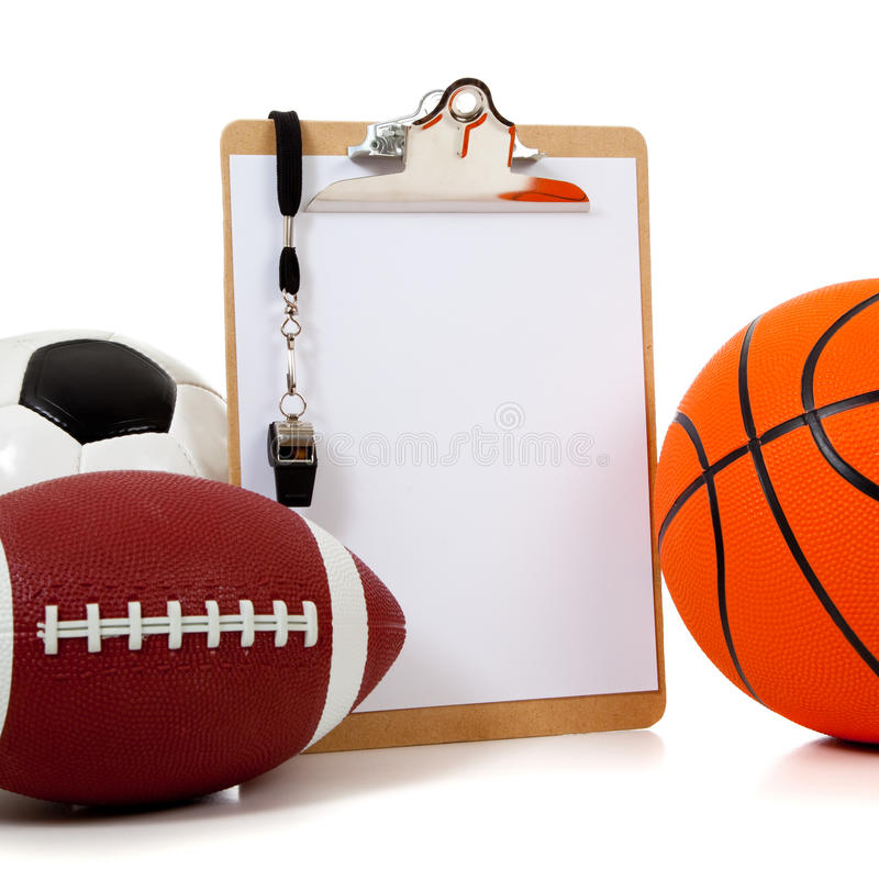 Assorted sports balls with a Clipboard royalty free stock image