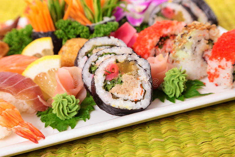 Assorted sushi selection on bamboo mat royalty free stock image