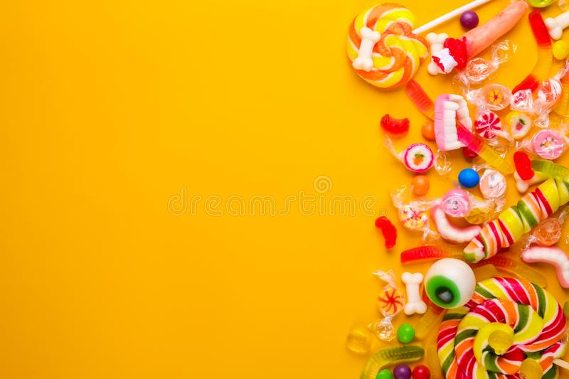 Multiple all hallows eve, treats for Halloween party on colorful background. royalty free stock photo