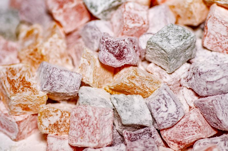 Assorted traditional turkish delight close up. Sugar coated soft candy. royalty free stock photography