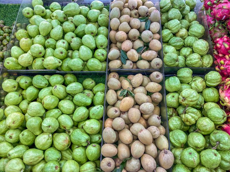 Assorted tropical fresh fruits for sale at hypermarket royalty free stock images