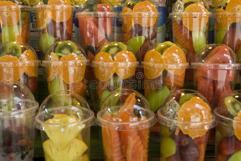 Assorted tropical fruit cups, close up stock photo