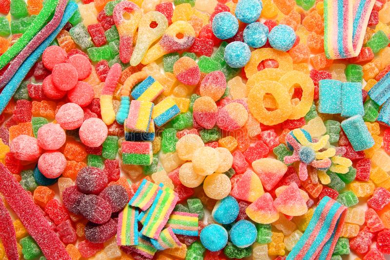 Assorted variety of sour candies includes extreme sour soft fruit chews, keys, tart candy belts and straws stock photos