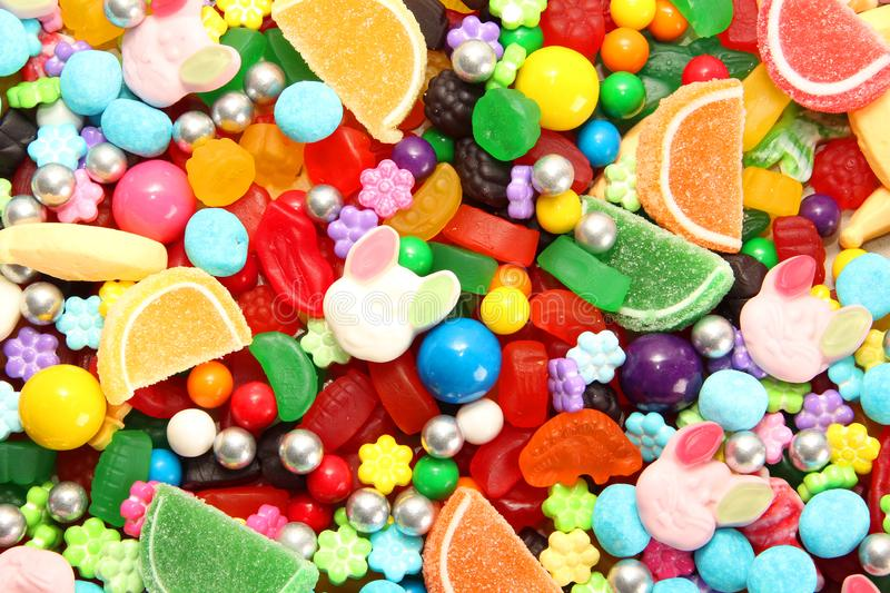 Assorted variety of sweet sugar candies includes, gummy bears, Easter bunny candy, gum balls and sugar fruit slices royalty free stock image