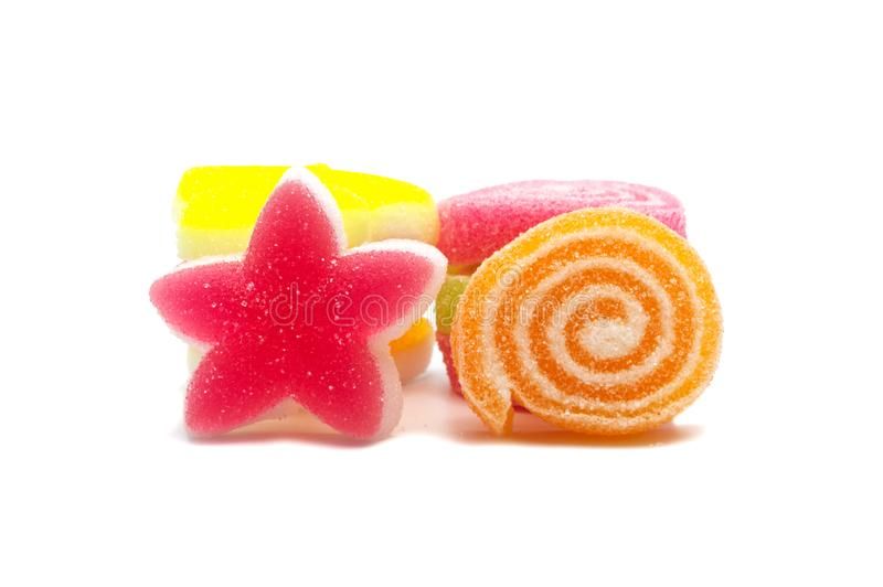 Assorted various bright candies colorful  gelatin jelly sweets, gummy sugary tasty. Soft gums viewed from above. stock photos