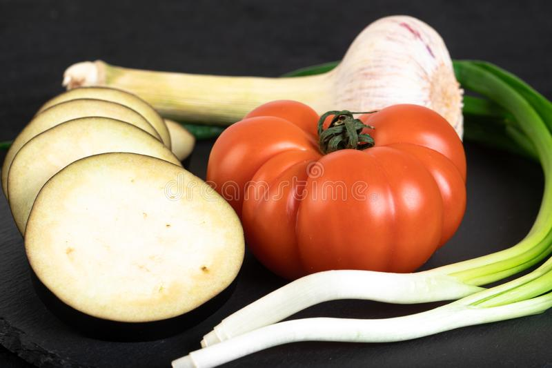 Assorted vegetables. Ob black stone plate stock photography