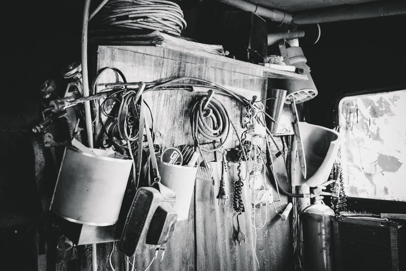 Assorted vintage items. Heap of old rusty things and tools stock photos