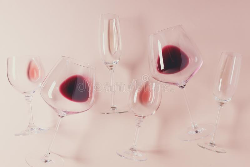 Assorted wineglasses with red, rose and white wine lying on pink background. Wine degustation concept. Flat lay. Top view. Copy. Space. Toned royalty free stock images