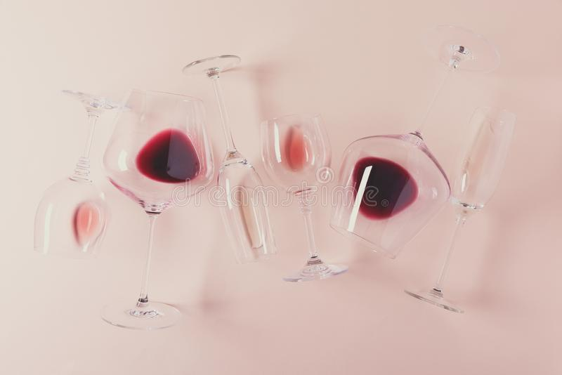 Assorted wineglasses with red, rose and white wine lying on pink background. Wine degustation concept. Flat lay. Top view. Copy. Space. Toned stock photo