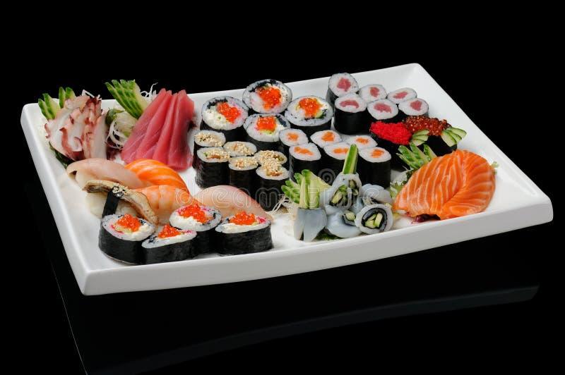 Assortiment van broodjes, sushi en sashimi royalty-vrije stock foto's