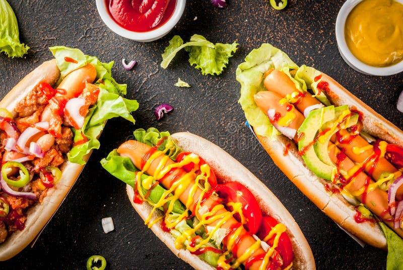 Assortiment van verschillende hotdogs stock foto