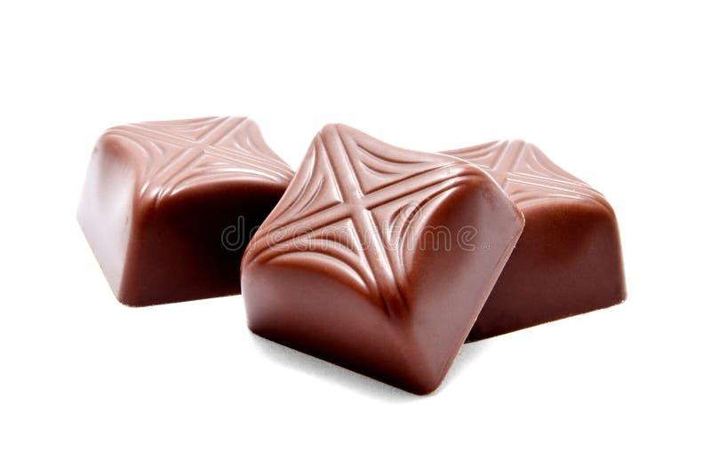 Assortimento dei dolci delle caramelle di cioccolato isolati fotografia stock libera da diritti