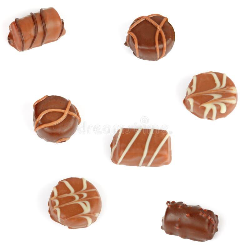 Assortimento delle caramelle di cioccolato isolate su fondo bianco immagini stock libere da diritti