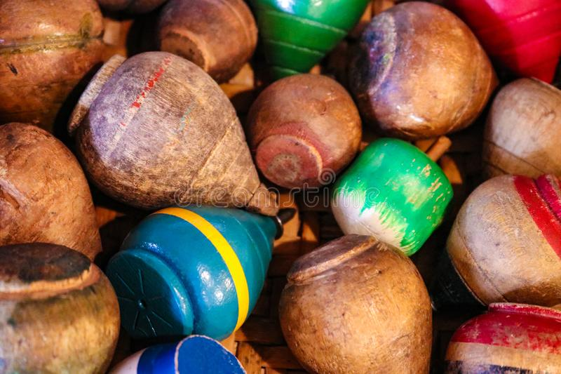 Assortment of antique wooden tops in a wooden box - selective focus stock image