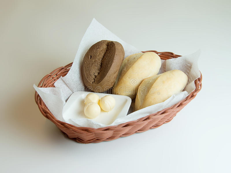 Assortment of baked bread in basket on white background royalty free stock images
