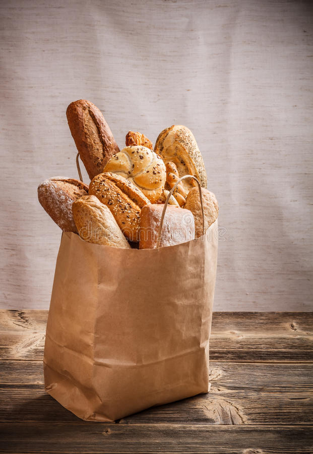 Assortment of baked goods. Packaged in a paper bag stock image