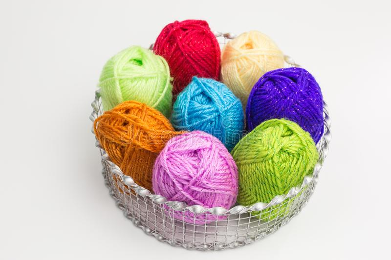 Balls of wool. Assortment of balls of wool in bright colors in a basket royalty free stock photos