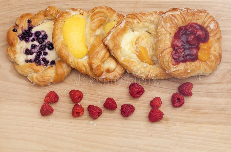 Assortment of cheese danishes puff pastry with blackberries, vanAssortment of cheese danishes puff pastry with blackberries, vanil stock photography