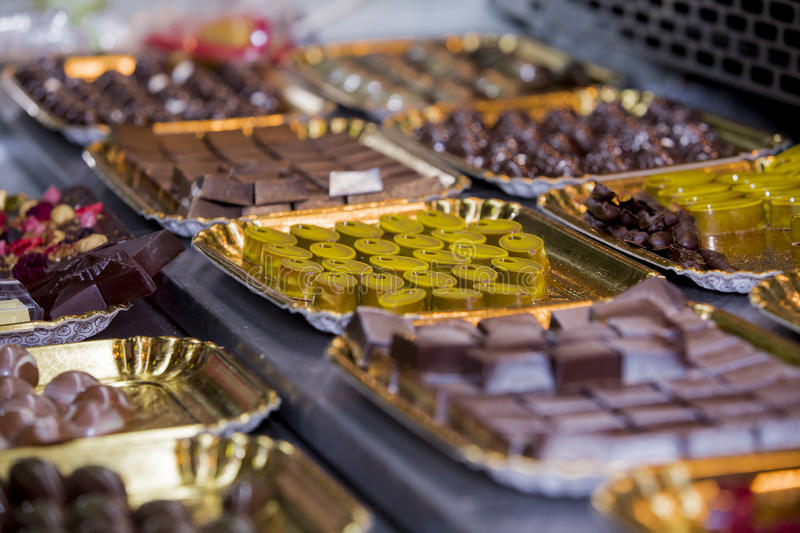 Assortment of chocolates. In the shop window royalty free stock images