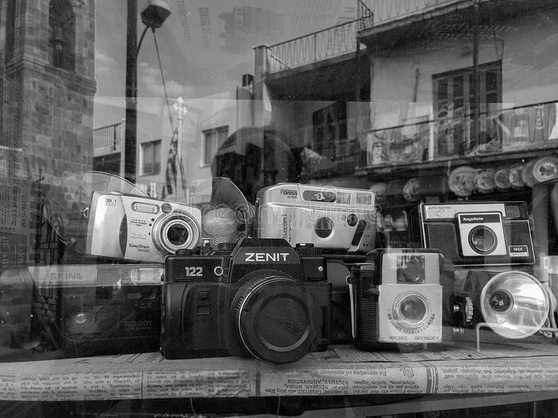An assortment of classic vintage film cameras and flash units di stock photography