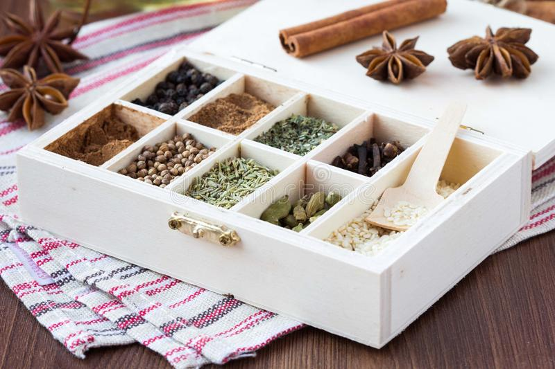 Assortment collection of spices and herb in wooden box, food background stock image