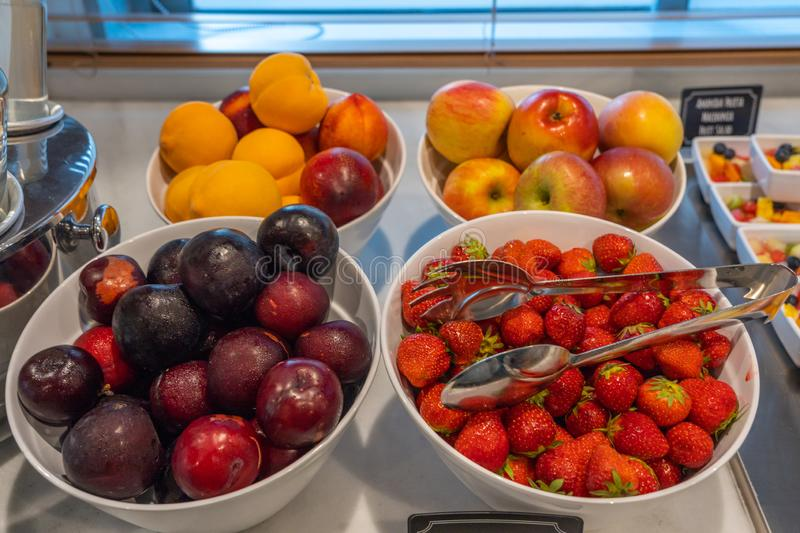 Assortment of colorful fresh fruits at breakfast buffet in hotel. Assortment of colorful fresh fruits at breakfast buffet counter in hotel stock photo
