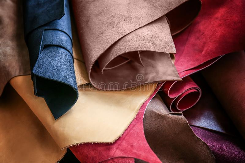 Assortment of colorful leather pieces stock images