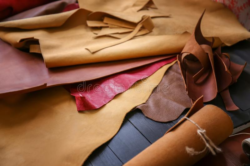 Assortment of colorful leather pieces on table stock photo
