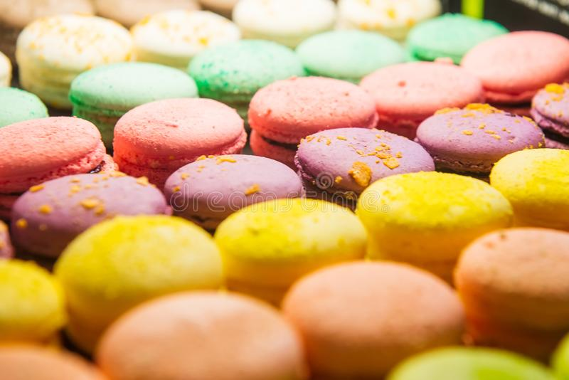 Assortment of Colorful macarons for sale in shop. Rows of macaroons in candy shop, storefront with sweets, cafe showcase. Traditio royalty free stock images