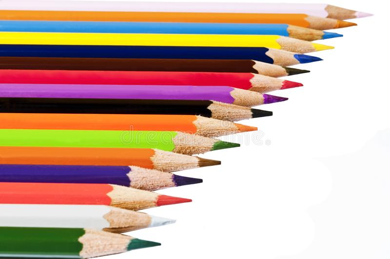 Assortment of coloured pencils with shadow on white background stock photography