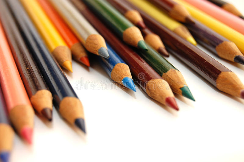 Assortment of coloured pencils on white background stock photo