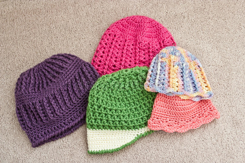 Assortment of Crocheted Hats. Colorful group of crocheted hat in various styles stock photo