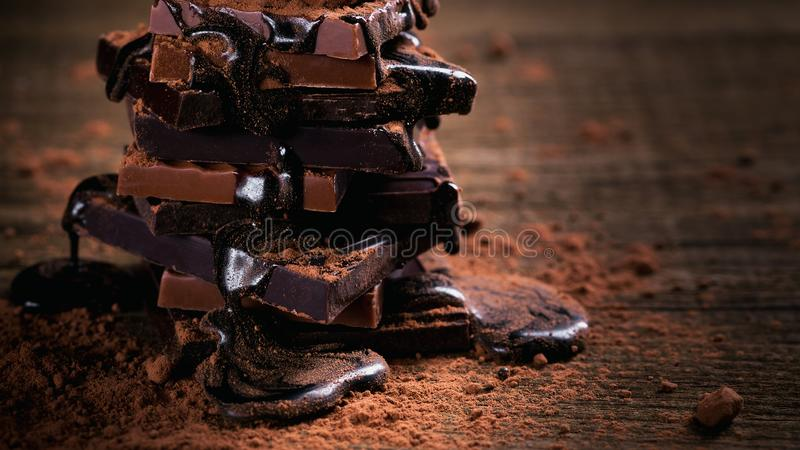 Assortment of dark and milk chocolate stack, truffles royalty free stock images