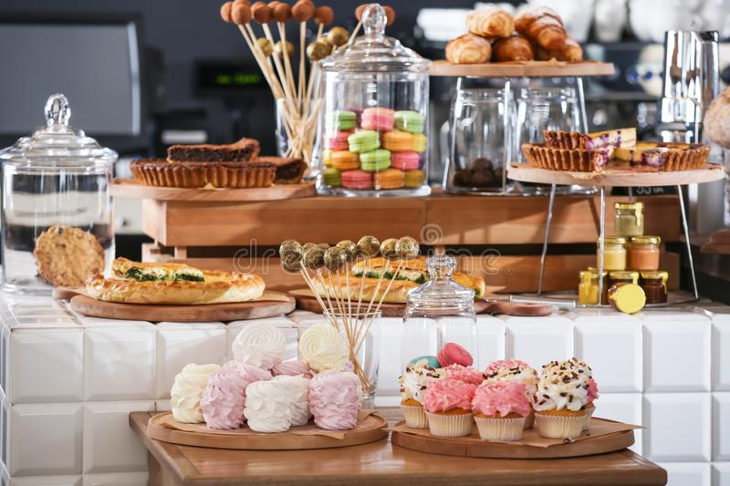 Assortment of delicious pastries and sweets in shop stock images