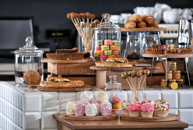 Assortment of delicious pastries and sweets in shop stock image
