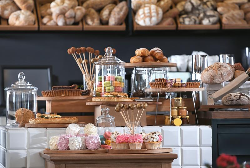 Assortment of delicious pastries and sweets in shop stock photography