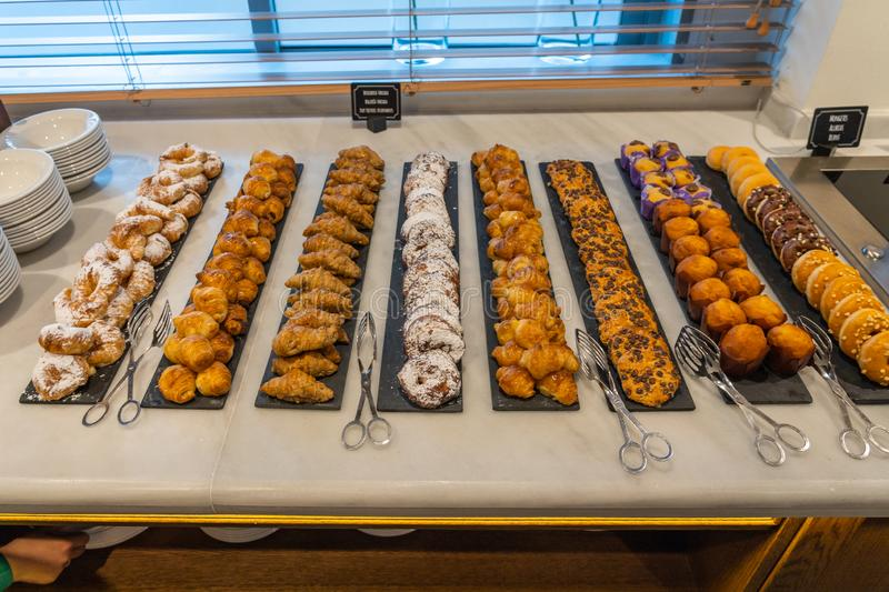 Assortment of delicious pastry beautifully arranged at buffet restaurant royalty free stock image