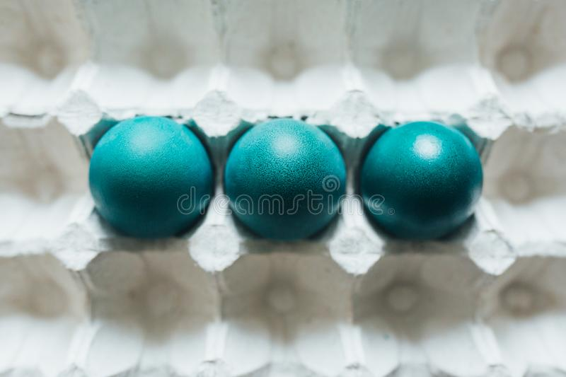 Assortment of different color, fresh, chicken eggs in a gray tray background royalty free stock photography