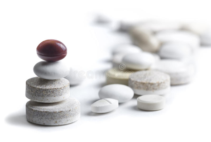 Assortment of Different Pills. Many different types of pills balanced on top of each other stock photos