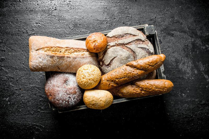 Assortment of different types of bread in the basket stock photos
