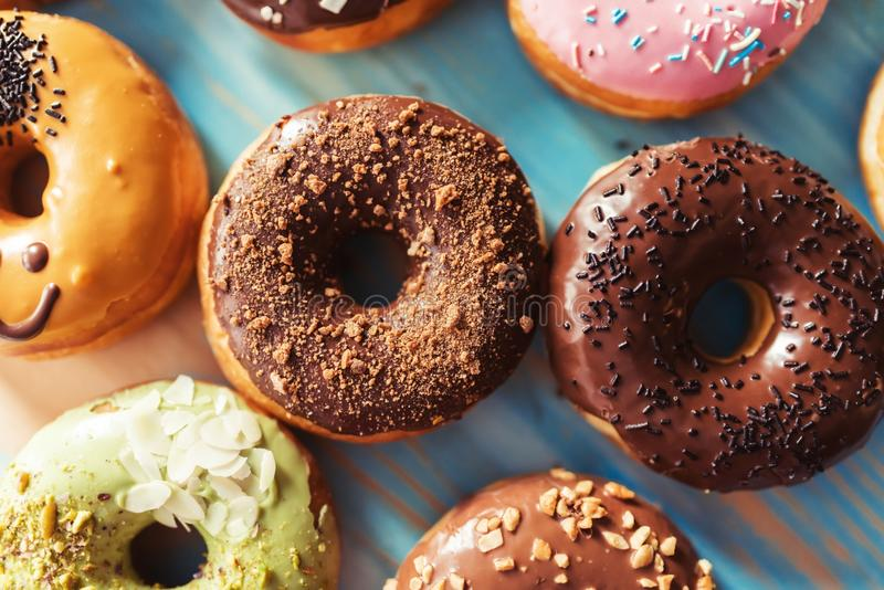 Assortment of donuts on a table. Assortment of donuts on a blue wooden table stock photography