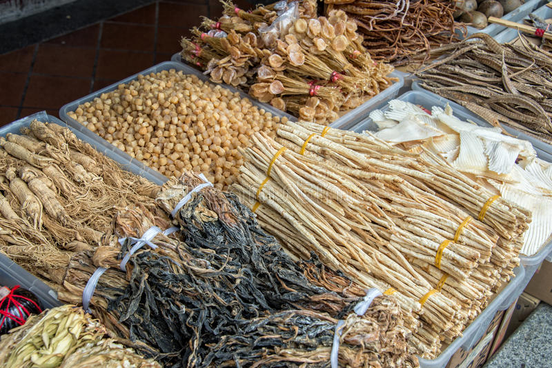 Assortment of dried plants used for traditional chinese herbal medicine. In a street stock images