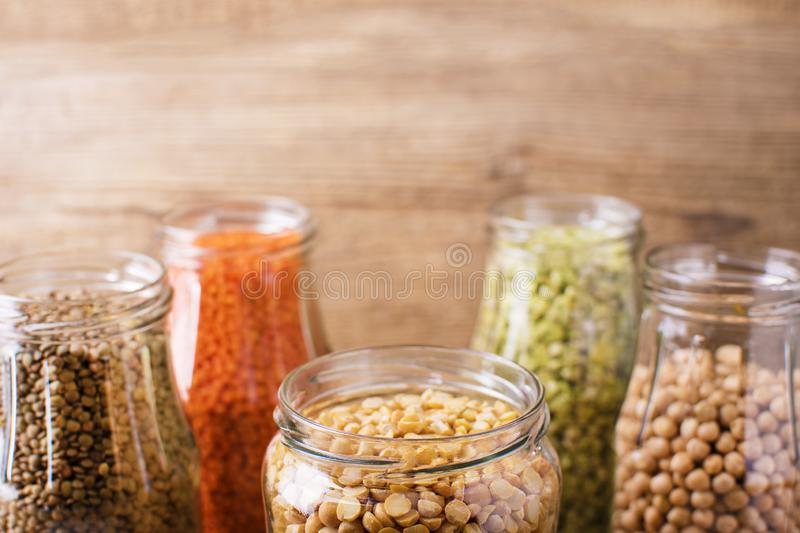 Assortment of dry organic beans and lentils in glass jars . Variety of raw legumes. stock photography