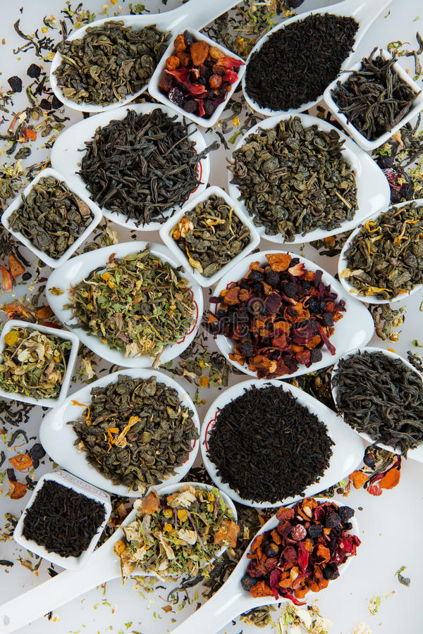 Assortment of dry tea. Various kinds of tea isolated on white.Different kinds of tea leaves. Tea composition with different kind stock photography