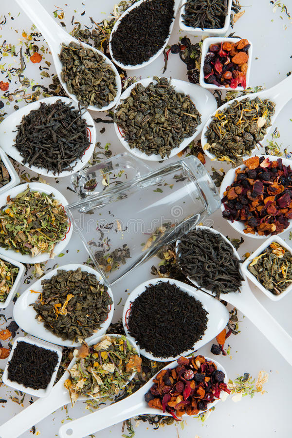 Assortment of dry tea. Various kinds of tea isolated on white.Different kinds of tea leaves. Tea composition with different kind stock photos