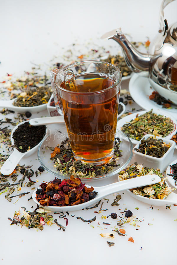 Assortment of dry tea. Various kinds of tea isolated on white.Different kinds of tea leaves. Tea composition with different kind royalty free stock photography