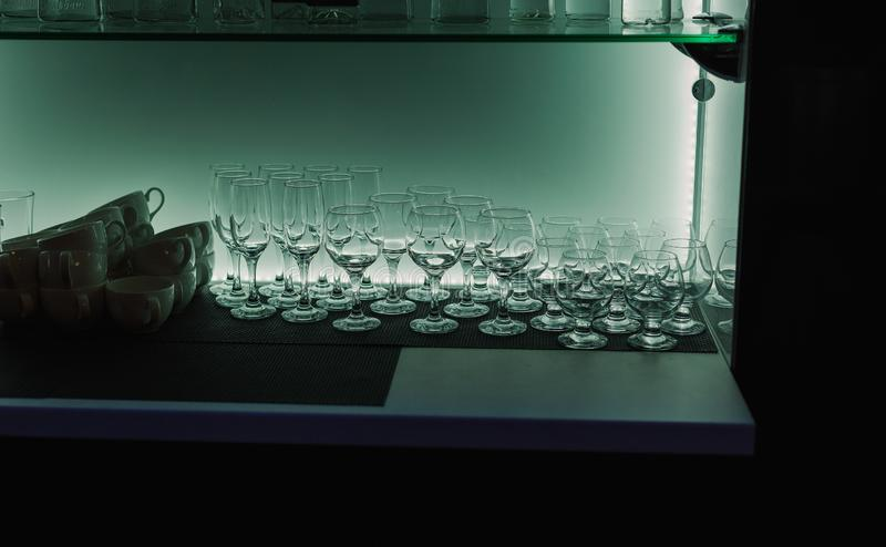 An assortment of empty crystal glasses for each type of beverage in transparency. royalty free stock images