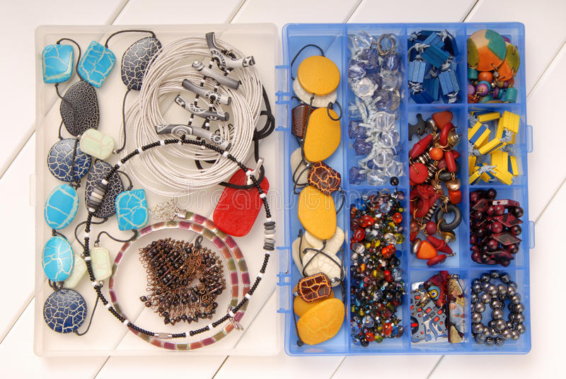 Assortment of female accessories, bijouterie is in box, beads, e royalty free stock photos