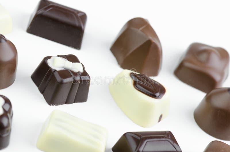 Assortment Of Fine Chocolates. In White, Dark And Milk Chocolate On White Background stock photos