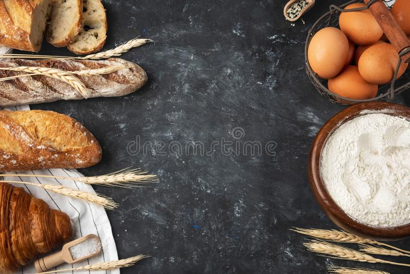 Assortment of fresh bread, baking ingredients. Still life captured from above, banner layout.Healthy homemade bread. royalty free stock photos